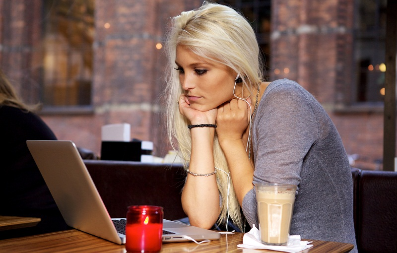 Woman with laptop on cafe