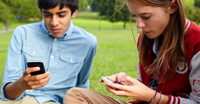 mobile phone in teen's hand